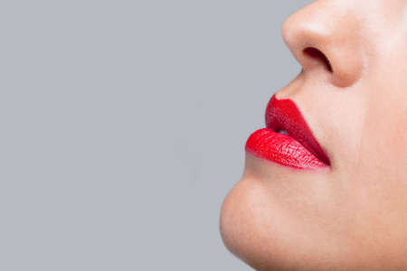 Close up of a womans face with bright red lipstick on her lips. Stock Photo - 6444169