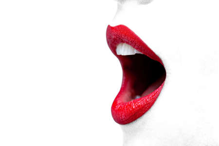 Close up of a womans mouth wide open with bright red lipstick on her lips. photo