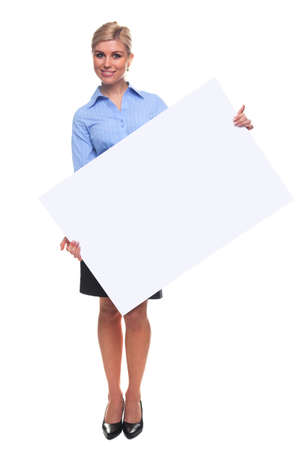 notice: An attractive blond woman holding a blank sign looking towards camera, the board is a uniform color so you can make it larger if you wish to add your own image or message.