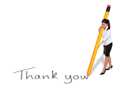 Businesswoman writing the words Thank you with a giant pencil, isolated on a white background. Stock Photo