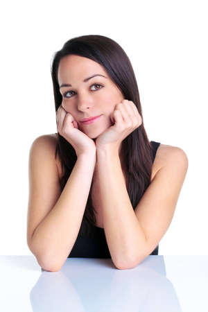 An attractive brunette woman in her twenties leaning on her elbows as she thinks about something, white background. Stock Photo - 7056881