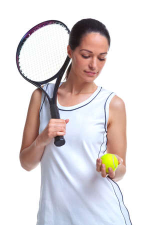 Woman tennis player holding a racket and ball, isolated on a white background. photo