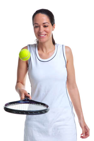 A woman tennis player bouncing the ball on the racket, isolated on a white background. photo
