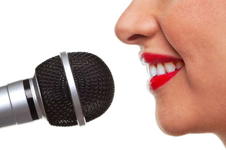 using voice: Close up of a woman using a microphone, isolated on a white background.