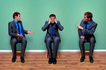 Concept image of a businessman having an argument with himself photo