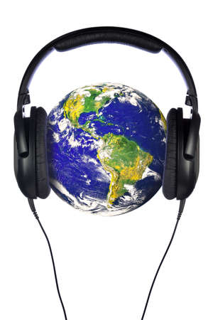 public domain: A pair of headphones on the world, globe courtesy of NASA public domain images. Isolated on a white background.