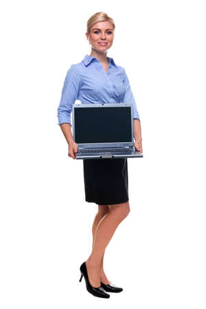 Full length shot of an attractive blond woman holding a laptop computer, photo