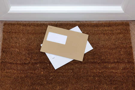 letterbox: Two envelopes on a doormat, blank window to add your own name and address details.