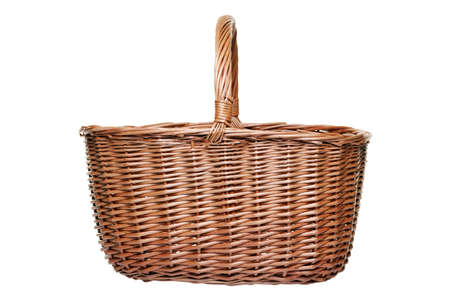 Traditional wicker shopping basket weaved from willow, isolated on a white background. photo