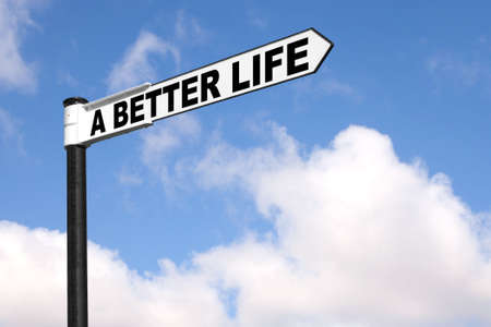 new direction: Concept image of a black and white signpost with the words A Better Life against a blue cloudy sky. Stock Photo