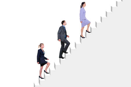 advancement: Three business people climbing a flight of stairs, white background.