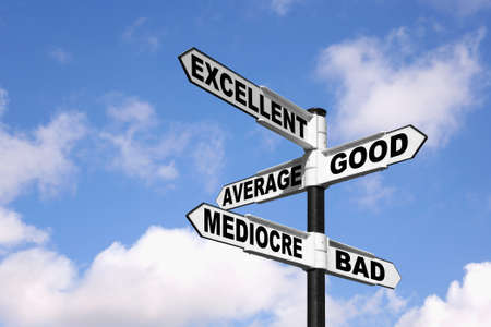 Signpost with the words Excellent, Good, Average, Mediocre and Bad against a blue cloudy sky. Stock Photo - 7971141