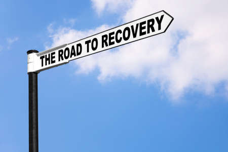 economic recovery: Concept signpost image for the saying The road to recovery. Good image for healthcare or financial related themes. Stock Photo
