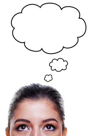 upwards: Brunette woman with big brown eyes looking upwards with thought bubbles above her head, isolated on white background.