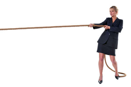 business rival: A blond businesswoman pulling on a long piece of rope, isolated on a white background.