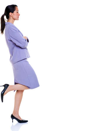 succesful woman: Attractive professional business woman with her foot up resting against the side, isolated on a white background.