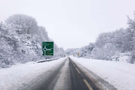british weather: The A31 road at the junction with the A32 roundabout during the snow in January 2010