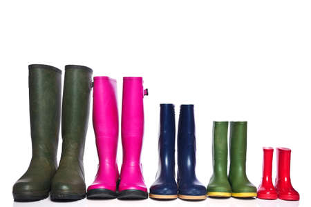 wellies: A group of wellie boots isolated on a white background.