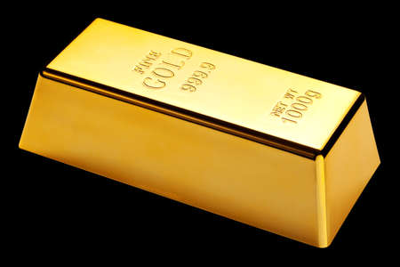 Photo of a 1kg gold bar isolated on a black background photo