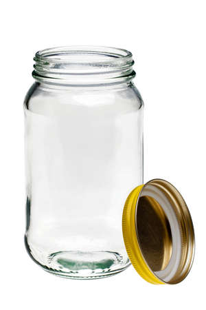 lid: Glass jar with lid to the side isolated on a white background.