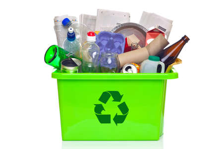 recycling bins: Photo of a green recycling bin full of recyclable items isolated on a white background.