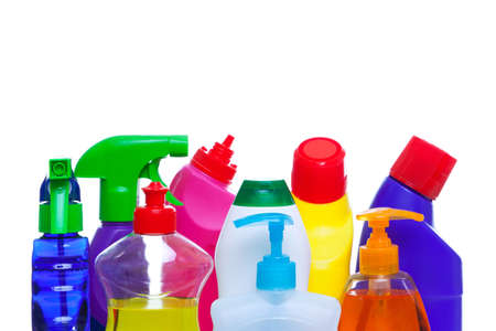 Photo of cleaning chemical bottles isoalted on a white background.