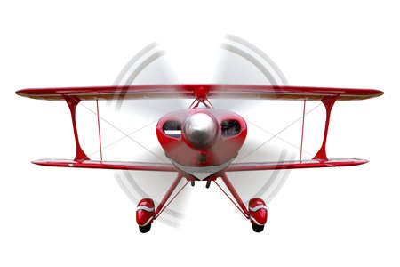 A red biplane, front view with propeller in motion, isolated on a white background.
