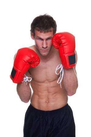 Male boxer in a defensive stance isolated on white background