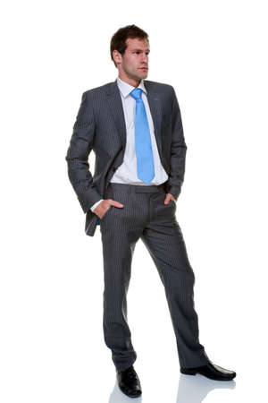 A businessman wearing a grey pinstripe suit and blue tie, isolated on a white background. Stock Photo - 8215384