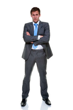 A businessman wearing a grey pinstripe suit and blue tie, isolated on a white background.Arms folded. Stock Photo - 8215385