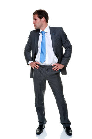 pinstripe: A businessman wearing a grey pinstripe suit and blue tie, isolated on a white background.
