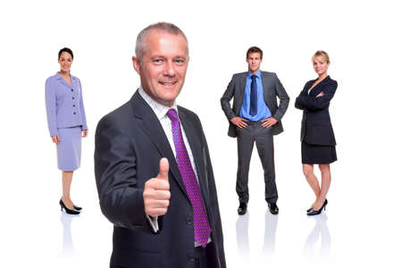 team from behind: A manager gesturing a thumbs up with a business team behind, isolated on a white background.