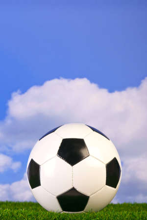 Photo of a football on grass with sky background. Stock Photo - 8394356