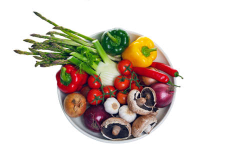 Photo of a bowl of vegetables shot from above and isolated on a white background, part of the ingredients for a mediterranean meal. Stock Photo - 8675780