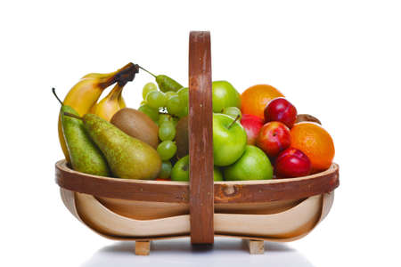Photo of a wooden trug full of fresh fruit, isolated on a white background. photo