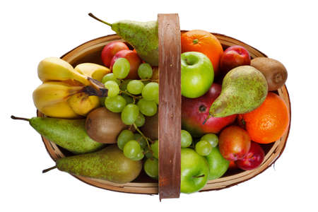 Photo of a wooden trug full of fresh fruit, shot from above and isolated on a white background. photo