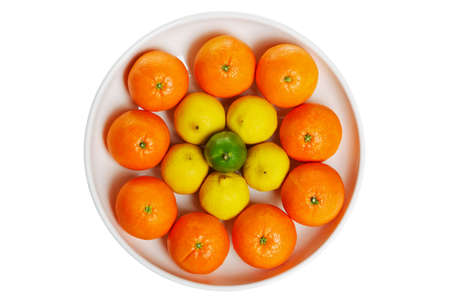 Photo of a bowl full of citrus fruits isolated on a white background photo