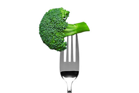 Photo of broccoli on a fork isolated on a white background, part of a series. photo