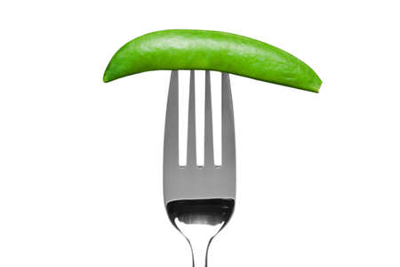 Photo of a sugar snap pea on a fork isolated on a white background, part of a series. photo