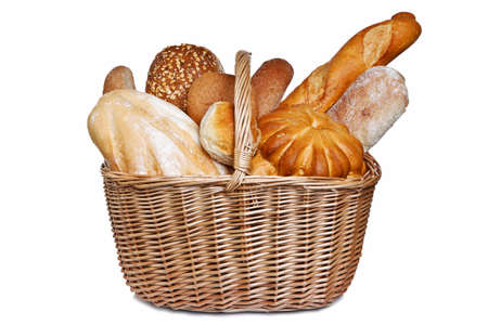 Photo of various types of bread in a wicker bascket isolated on a white background. photo