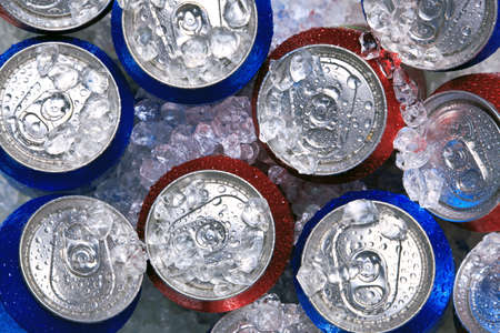Photo of cans of drink on crushed ice. photo