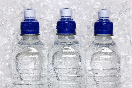chilled: Photo of cold mineral water in plastic bottles on crushed ice