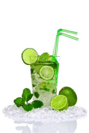 Photo of a Mojito cocktail with fresh lime and mint leaves isolated on a white background. Made with white rum, sugar, lime juice and soda water with mint leaves poured over crushed ice.