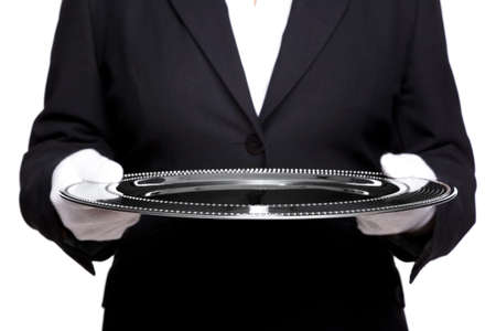 female butler holding a silver tray, isolated against a white background Stock Photo - 8943981