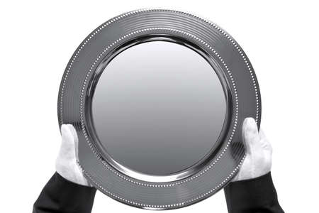 held: silver tray being held by a butler, shot from above and isolated on a white background.  Stock Photo