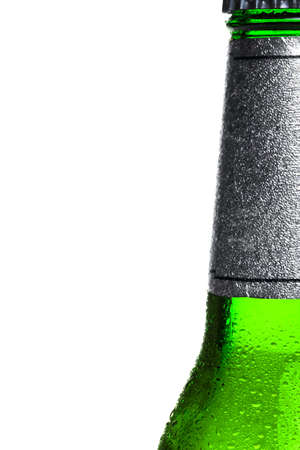 an ice cold bottle of beer, right of frame, white background. photo