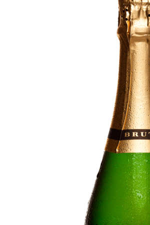 bouteille champagne: champagne bottle covered in water droplets, on right side of frame with white background.