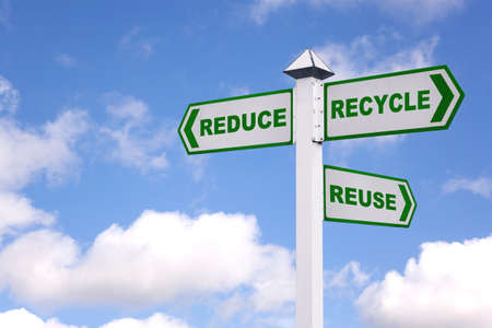 reduce reuse recycle: Recycling concept image of a signpost against a sky background with the 3 Rs in green text on the directional arrows, Reduce, recycle, reuse.