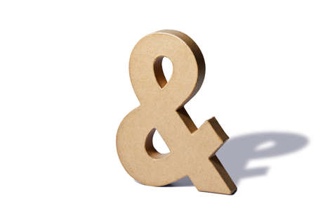 a recycled cardboard ampersand or and on a white background with shadow. photo