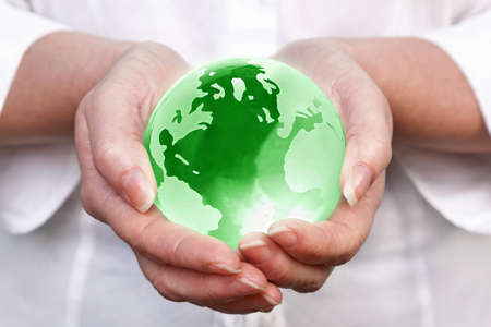 a woman holding a glass globe in her hands, concept image for worldwide and global related themes. Stock Photo - 9189293